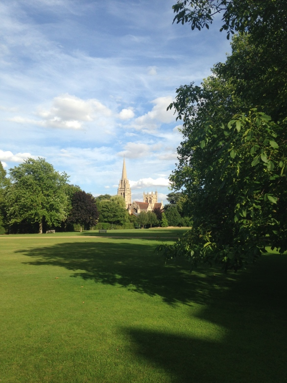 A lovely summer's day in Cambridge, looking across the grass at Downing, while heading to dinner on Day 2.
